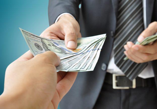 paying_dollars-623x432.jpg